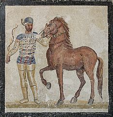 233px-Mosaic blue charioteer Massimo